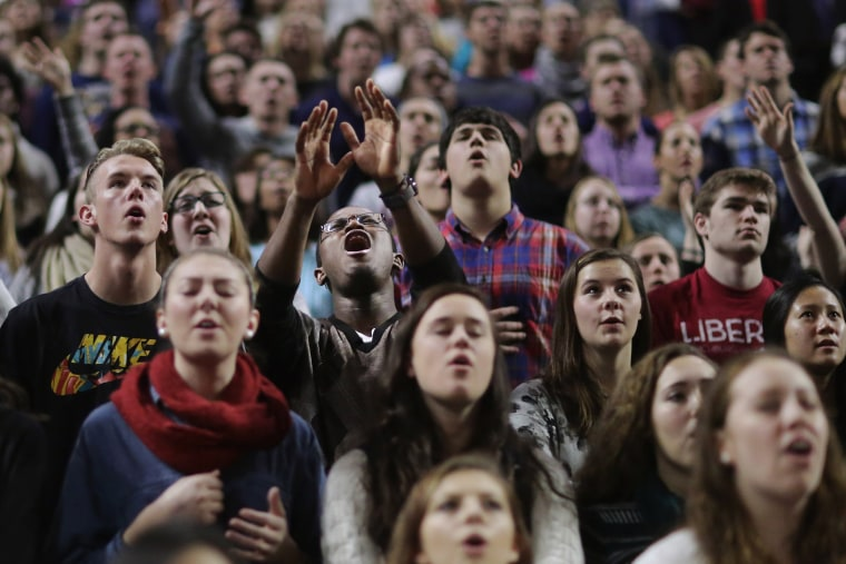 Image: Donald Trump supporters sing Christian songs before the Republican presidential candidate delivers the convocation