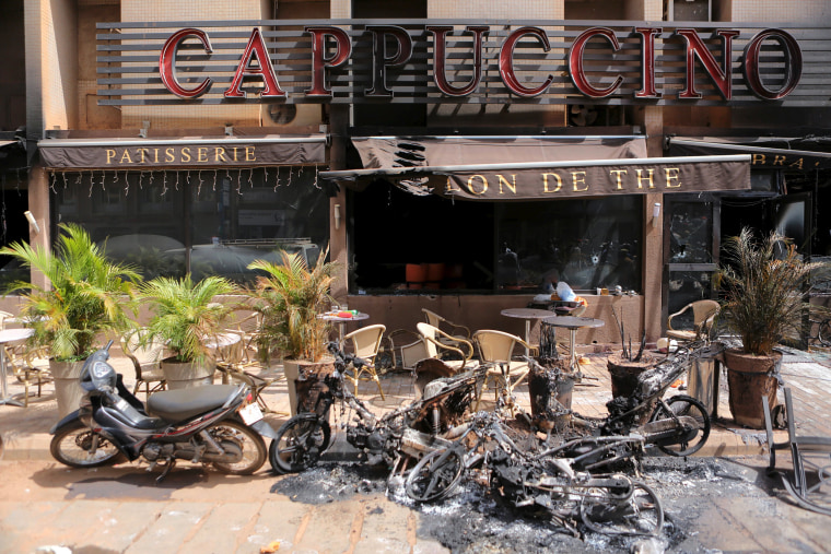 "Image: The burned-out exterior of ""Cappuccino"" restaurant is seen in Ouagadougou"