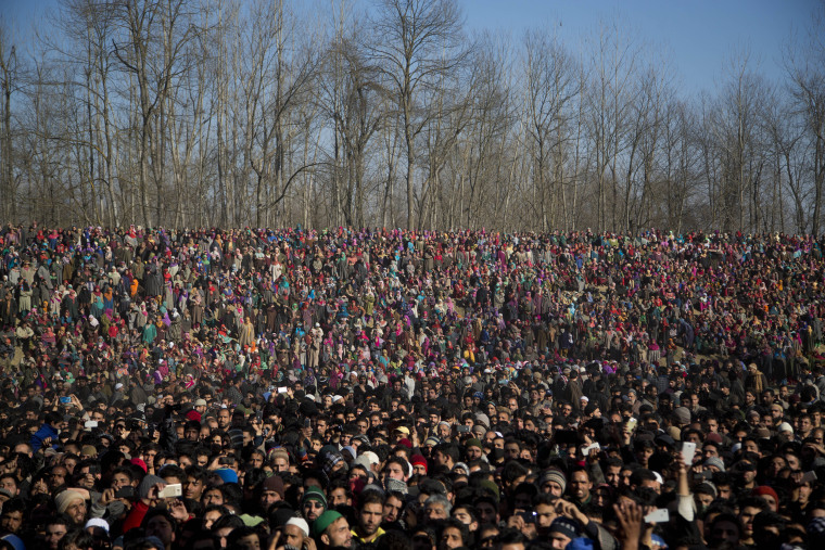 Image: Kashmiri Muslims watch the funeral procession of Shariq Ahmad Bhat