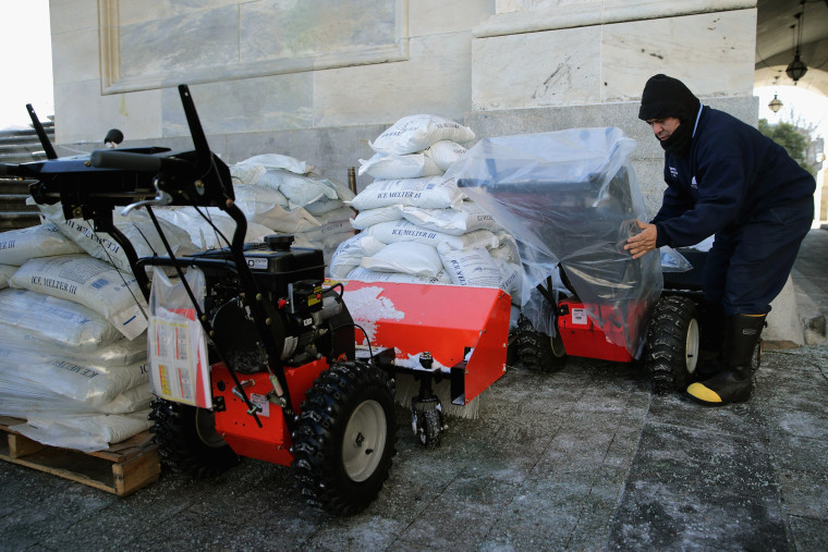 Image: A Stone covers gas powered snow sweepers in plastic bags