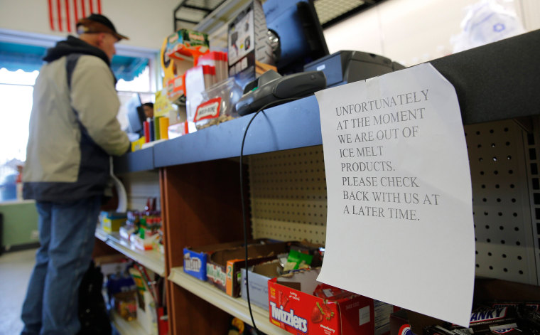 Image: A sign notifies customers of a temporary shortage of ice melts products at a hardware store