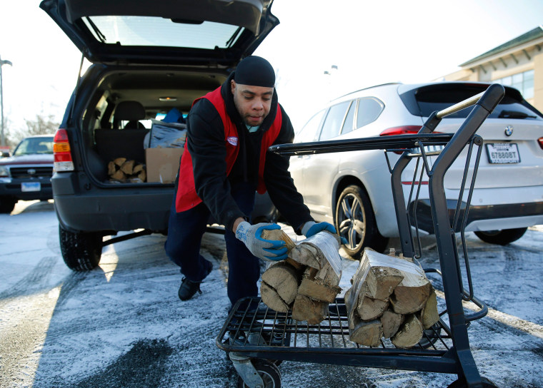 Image:An employee loads a customer's firewood at hardware store