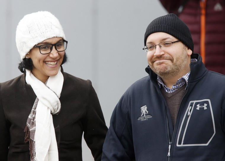 Image: U.S. journalist Jason Rezaian smiles next to his wife Yeganeh Salehi