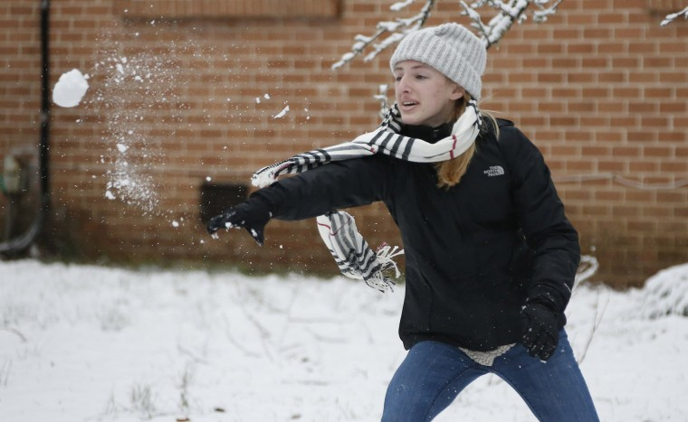 Image: A girl throws a snowball during a neighborhood snowball fight in Oxford, Miss.