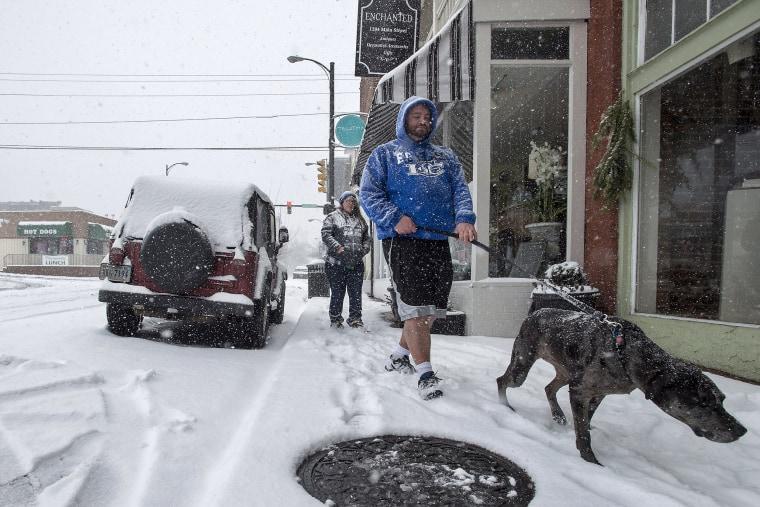 Image: A man walks his dog in Lynchburg, Va.