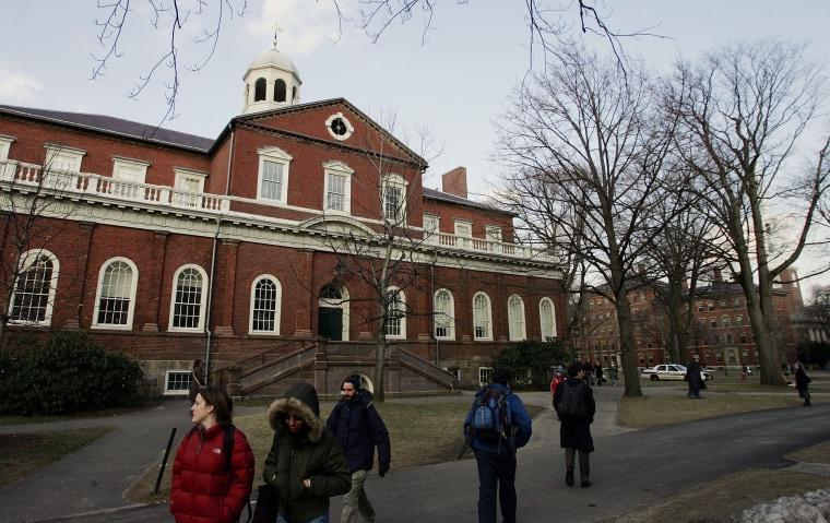 Harvard University students walk through the campus in February 2006 in Cambridge, Massachusetts.