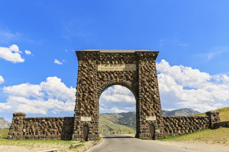 The Roosevelt Arch looms over the entrance to Yellowstone National Park in Montana.