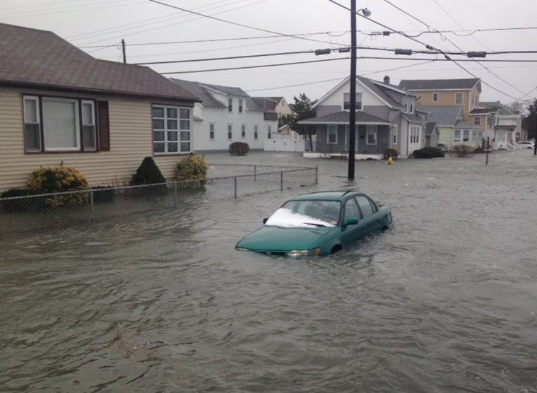 A car is submerged in floodwaters in North Wildwood, New Jersey, on Jan. 23.