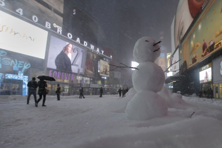Image: A snowman is pictured in Times Square in the Manhattan borough of New York