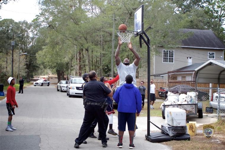 Image: Shaq plays basketball with Florida kids