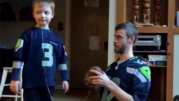 Dad uses football to extract son's loose tooth.