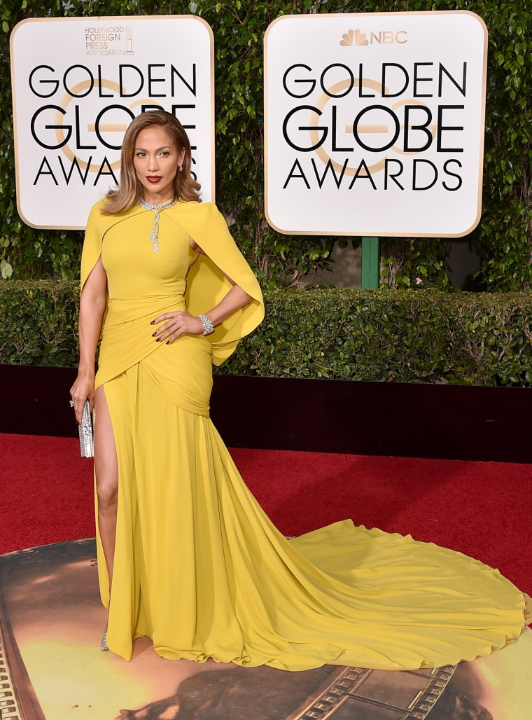 Jennifer Lopez arrives at the 73rd annual Golden Globe Awards on Sunday, Jan. 10, 2016, at the Beverly Hilton Hotel in Beverly Hills, California. Lopez wore a canary Giambattista Valli Haute Couture design, which she accessorized with glittering Jimmy Choo shoes, a Judith Leiber Couture crystal herringbone clutch and over 200 carats of Harry Winston Diamonds including a 46.95-carat Diamond wreath necklace.