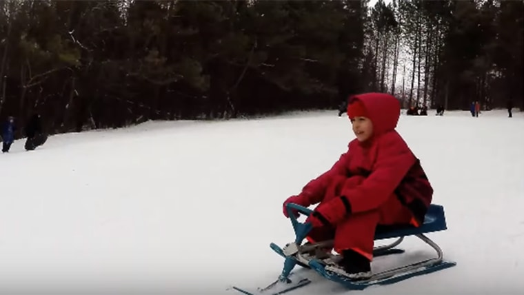 A local boy in Peterborough gave the Syrian children a gift of a stool racer they used to have fun sledding down Armour Hill in town.
