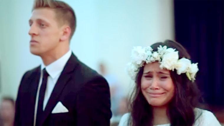Wedding couple react emotionally to Maori haka dance being performed.