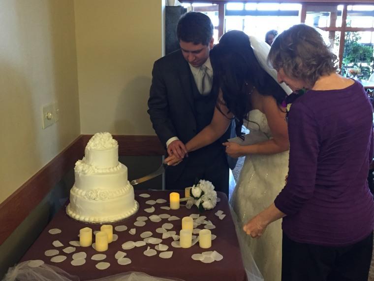 Julia, Justin, and Linda cut the cake