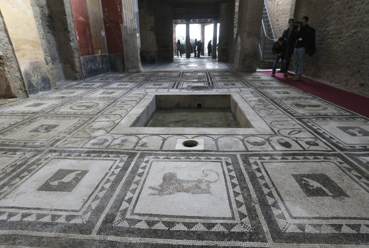 Image: A view of one of the six restored domus unveiled today during a ceremony led by Italian Prime Minister Matteo Renzi at the archaeological site of Pompeii, Italy