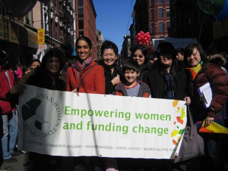 The Asian Women Giving Circle marched with Q-Wave, an Asian-American LGBT group, in Manhattan Chinatown's 2010 Lunar New Year Parade. This was the first year an LGBT group marched in the parade.