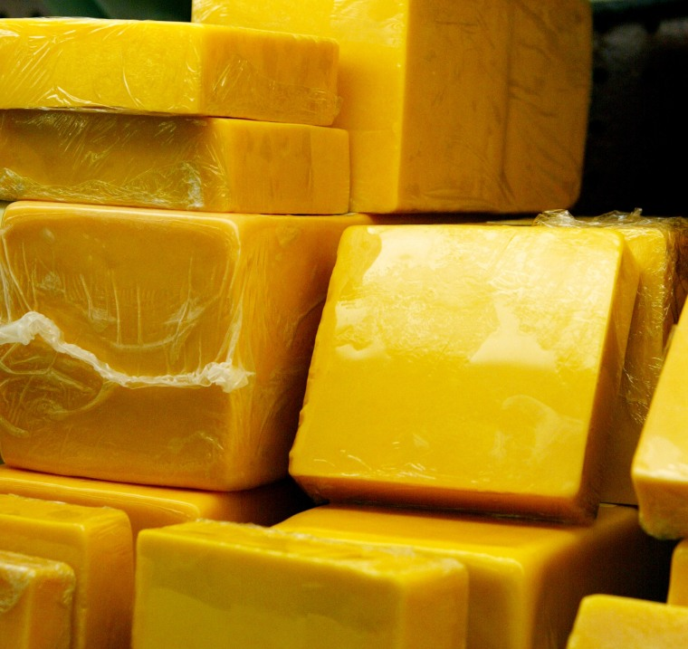 Image: Blocks of two-year cheddar cheese are displayed