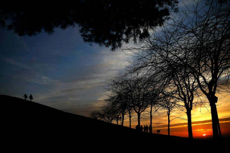 Image: People stroll alongside one of the hills of the Tio Pio park in Madrid