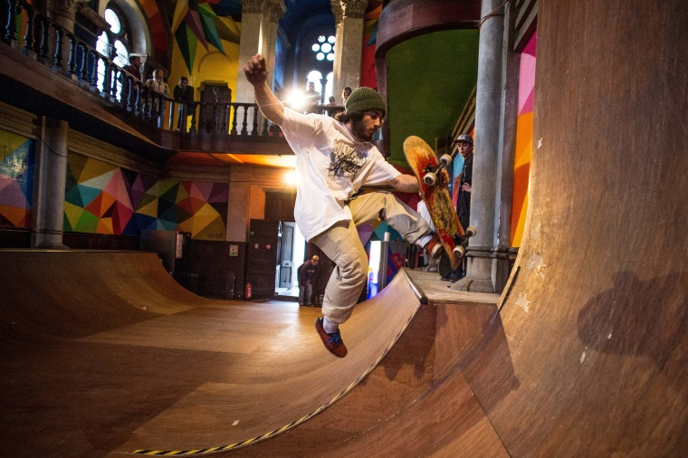 Image: A skater practices in a skate park inside the Santa Barbara church
