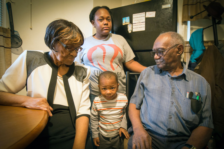 Elizabeth and Oscar Brown and their granddaughter Denettra and great-grandson Dana live in a Flint house with a lead service line and fear the 3-year-old has been poisoned.