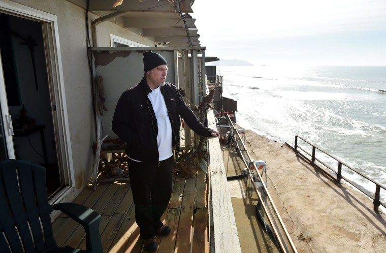 Image: Resident Jonathan Levin surveys missing land from his balcony