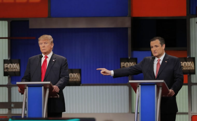 Image: File photo of Republican U.S. presidential candidate Cruz gesturing towards rival candidate Trump as he speaks at the Fox Business Network Republican presidential candidates debate in North Charleston