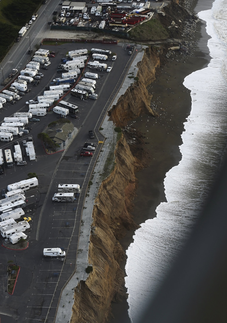Image: Waves lap at an eroding bluff at the San Francisco RV Resort in Pacifica