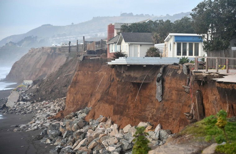 Image: Sections of land are seen missing from coastal properties in Pacifica