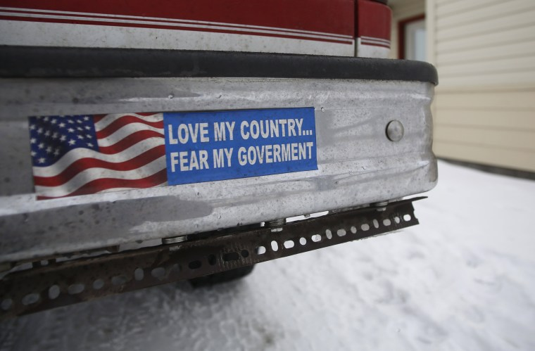 Image: A bumper sticker on a private truck is seen in front of a residential building at the Malheur National Wildlife Refuge near Burns, Oregon