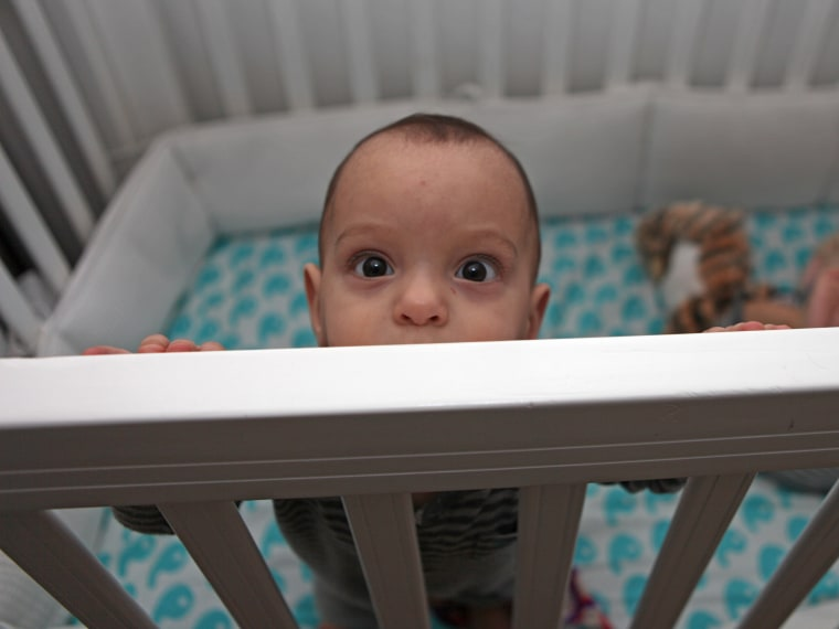 Baby in a crib.