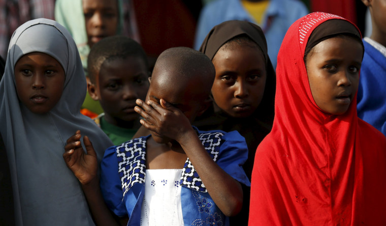 Image: Children attend prayers to pay respects to the Kenyan soldiers serving in AMISOM, who were killed in El Adde during an attack