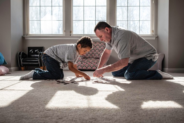 Image: Steve Elmore plays with his oldest son, Zion