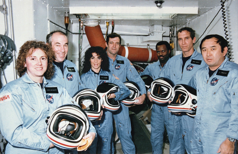 Image: Challenger's crew members stand in the White Room at Launch Pad 39B