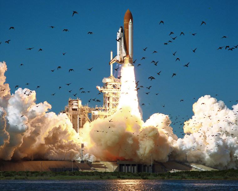 Image: A wide-angle view shows the ascent of the shuttle Challenger