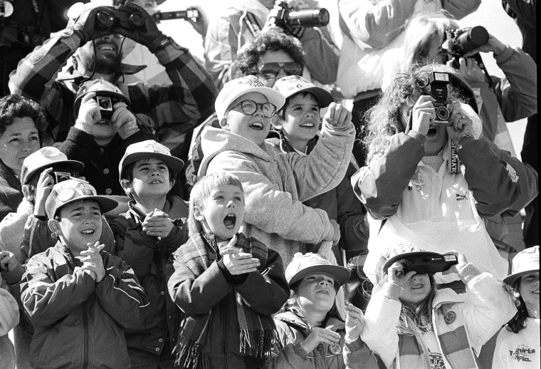 Image: Classmates of the son of America's first teacher-astronaut cheer as the space shuttle Challenger lifts skyward