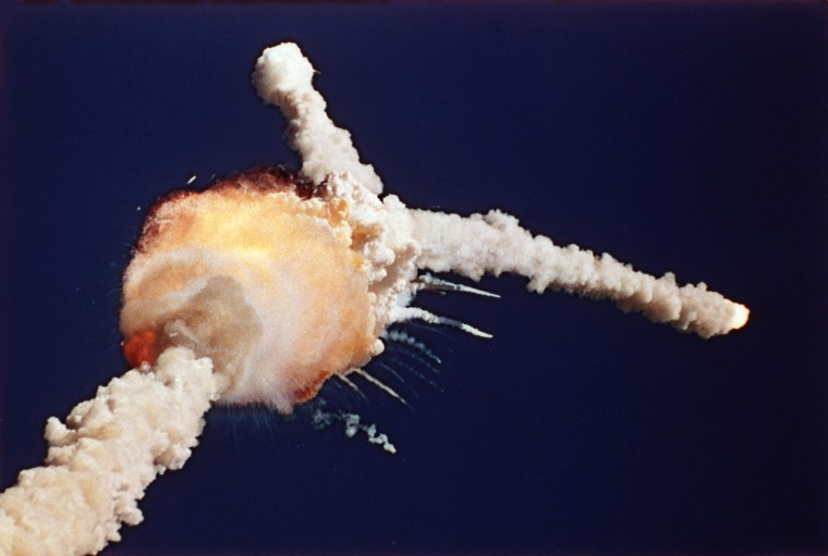 Image: An orange fireball marks the explosion of the space shuttle Challenger