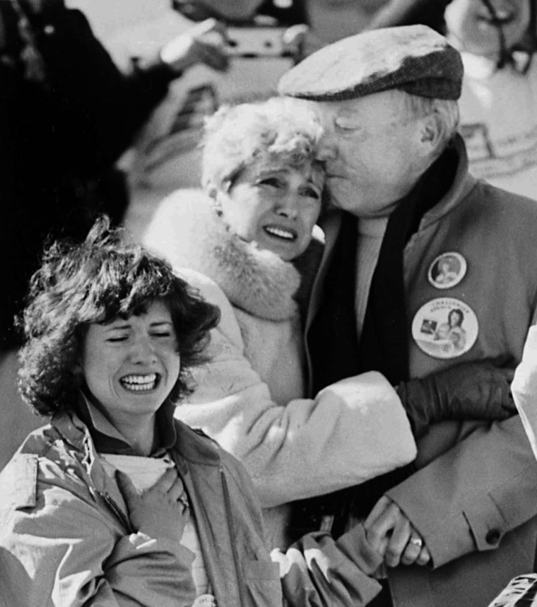 Image: Members of teacher-astronaut Christa McAuliffe's family react shortly after the failed liftoff