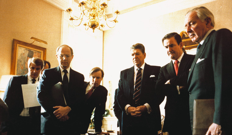 Image: President Ronald Reagan watches a TV replay of the Challenger shuttle explosion