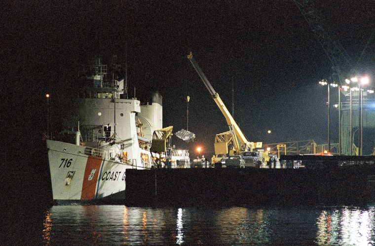 Image: Debris from the ill-fated shuttle Challenger is unloaded from the Coast Guard cutter Dallas