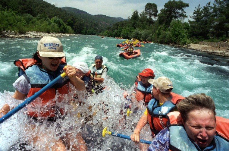 Image: Russian tourists enjoying white-water rafting