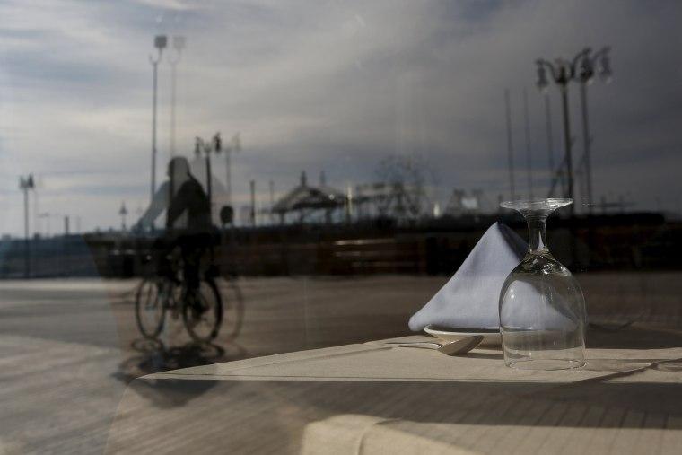 Image: An empty table inside a boardwalk restaurant