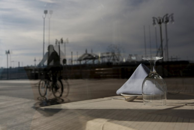 Image: An empty table inside a boardwalk restaurant