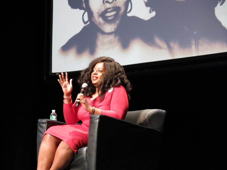 Now a professor at The New School in New York City, Dr. Robin J Hayes talks to the more than 300 audience members at the Schomburg Center about educational opportunities in Cuba.  (Photo By Melissa Noel)