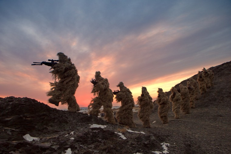 Image: Soldiers of the People's Liberation Army Marine Corps are seen in training at a military training base in Bayingol