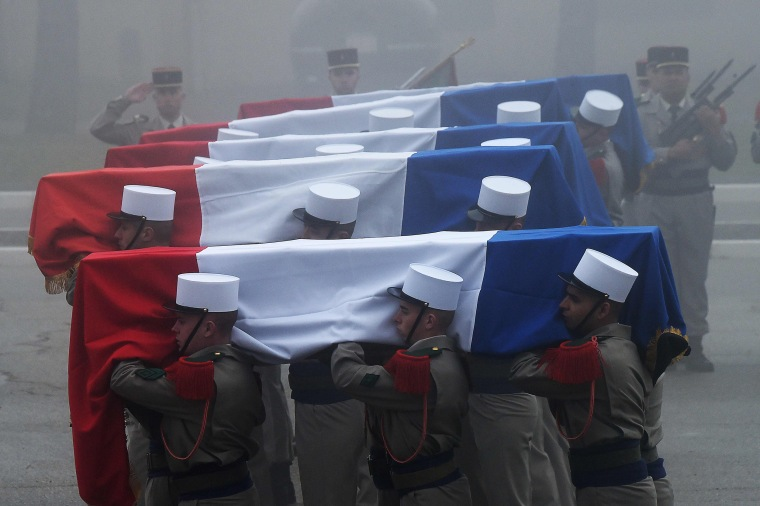 Image: Soldiers carry the coffins of the six French Foreign Legionnaires who died following an avalanche in the Alps