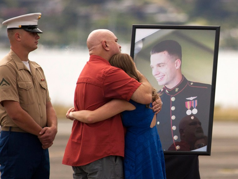 Image: Family gathers for a memorial service for the 12 Marines who died when their helicopters crashed off the North Shore of Oahu