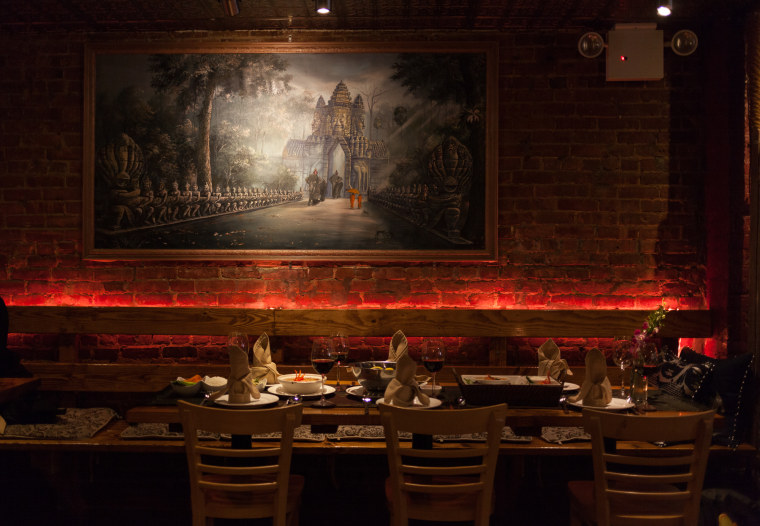 Angkor Cambodian Bistro features dim lights and soft music. A painting of the famous Angkor Wat temple is displayed in the dining room.