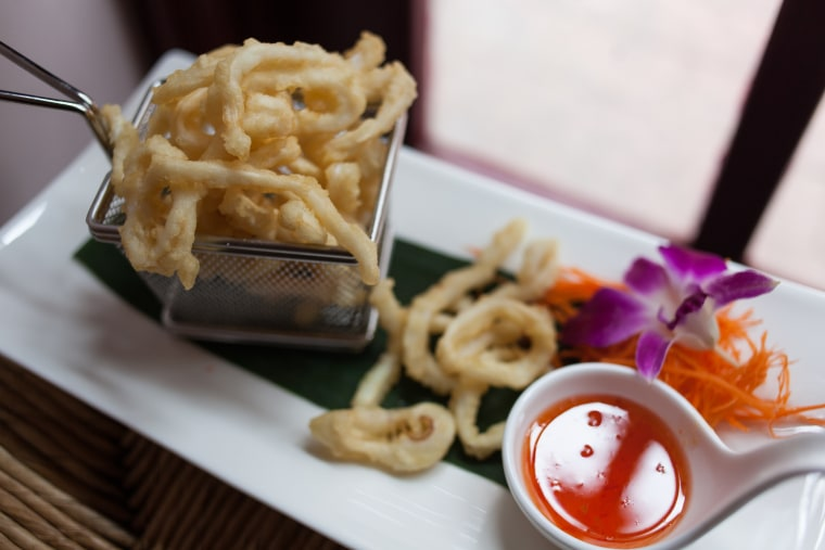 Fried calamari with a sweet and spicy sauce is available as an appetizer.