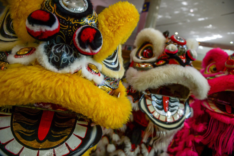 Image: Traditional lion dance performers at an event